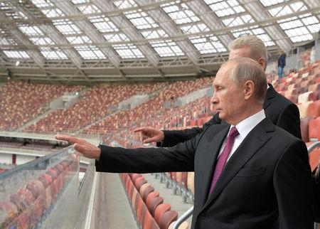 FILE PHOTO: Russian President Vladimir Putin listens to Moscow Mayor Sergei Sobyanin as they inspect the Luzhniki Stadium, which will host matches of the 2018 FIFA World Cup, in Moscow, Russia September 9, 2017. Sputnik/Alexei Druzhinin/Kremlin via REUTERS/File Photo