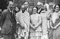 Group photograph taken at Marseilles in France 1931: C. F. Andrews, Gandhi, Miss Muriel Lester, Mahadev Desai, Madeleine Slade (Mirabehn), Pyarelal and an English friend. Mohandas Gandhi (1869 Ð 1948) was the preeminent leader of the Indian independence movement in British-ruled India. (Photo by: Universal History Archive/Universal Images Group via Getty Images)