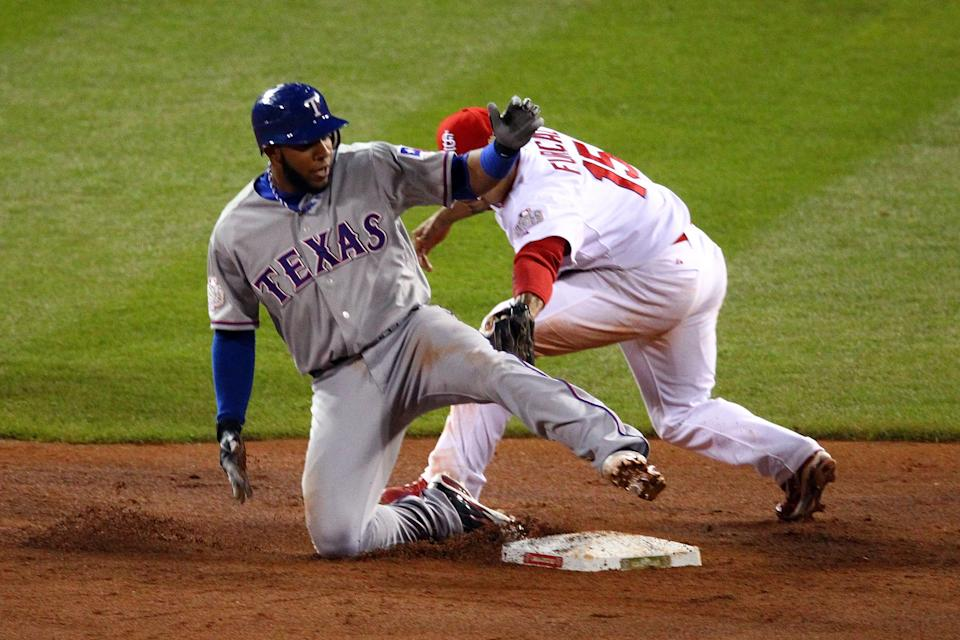 ST LOUIS, MO - OCTOBER 20: Elvis Andrus #1 of the Texas Rangers slides into second base ahead of the tag by Rafael Furcal #15 of the St. Louis Cardinals after hitting a single and advancing on the throw in the ninth inning during Game Two of the MLB World Series against the St. Louis Cardinals at Busch Stadium on October 20, 2011 in St Louis, Missouri. (Photo by Dilip Vishwanat/Getty Images)