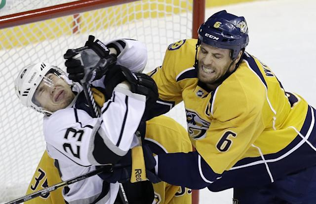 Nashville Predators defenseman Shea Weber (6) clears Los Angeles Kings right wing Dustin Brown (23) from in front of the net in the first period of an NHL hockey game Thursday, Oct. 17, 2013, in Nashville, Tenn. (AP Photo/Mark Humphrey)