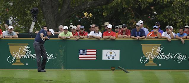 United States team player Phil Mickelson tees off on the fourth hole during a four-ball match against the International team at the Presidents Cup golf tournament at Muirfield Village Golf Club Thursday, Oct. 3, 2013, in Dublin, Ohio. (AP Photo/Darron Cummings)