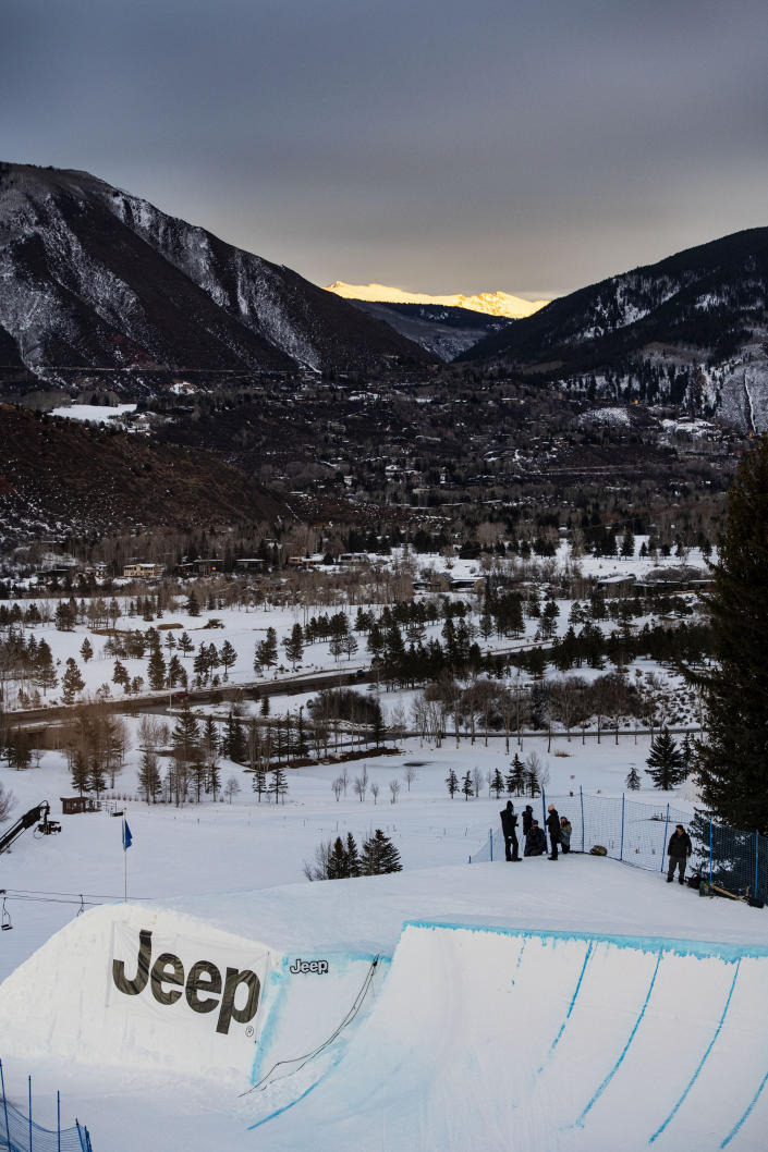 The sun sets during the knuckle huck and big air ski practice for the Winter X Games at Buttermilk on Thursday, Jan. 28, 2021, in Aspen, Colo. (Kelsey Brunner/The Aspen Times via AP)