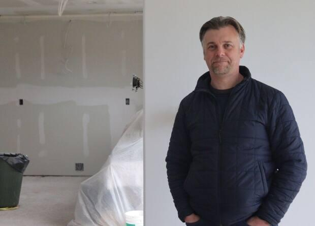 Joe McGrath and his wife have been making do with a renovation that remains unfinished. Construction costs soared after they locked down plans to take advantage of a provincial rebate program.  (Kyle Mooney/CBC - image credit)