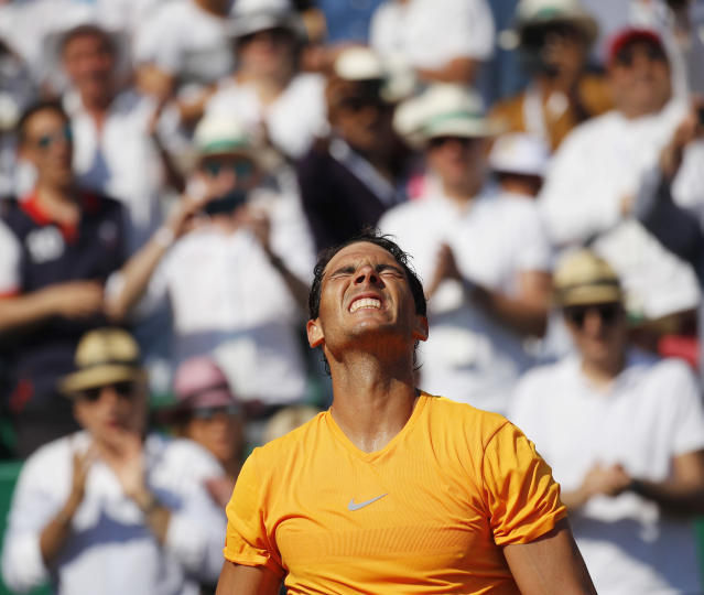 Spain's Rafael Nadal celebrates winning the men's singles final match of the Monte Carlo Tennis Masters tournament against Japan's Kei Nishikori in two sets, 6-3, 6-2, in Monaco, Sunday April 22, 2018. (AP Photo/Christophe Ena)