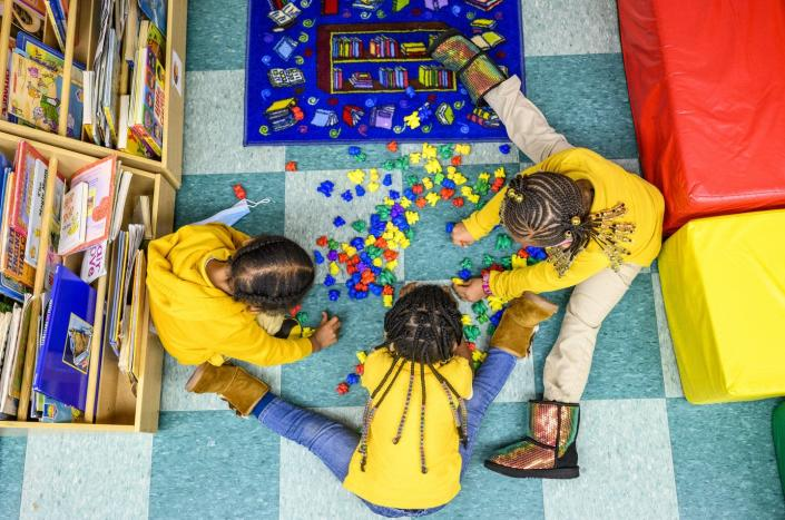 """<span class=""""caption"""">Child care and preschool are a strain on family budgets.</span> <span class=""""attribution""""><a class=""""link rapid-noclick-resp"""" href=""""https://www.gettyimages.com/detail/news-photo/cash-cain-brielle-kelly-and-journee-simon-play-together-n-news-photo/1232619181"""" rel=""""nofollow noopener"""" target=""""_blank"""" data-ylk=""""slk:Matt Roth for The Washington Post via Getty Images"""">Matt Roth for The Washington Post via Getty Images</a></span>"""