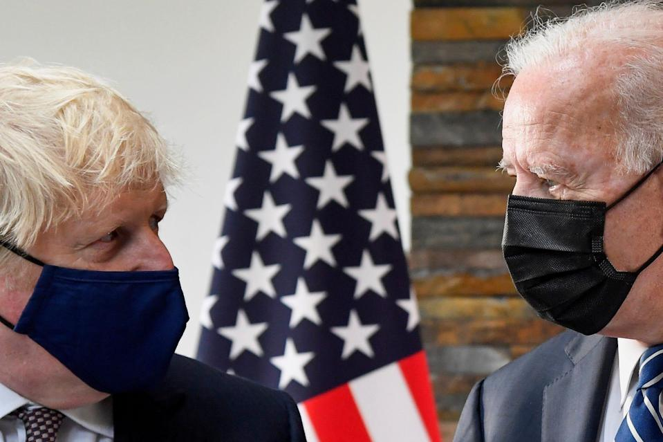 President Joe Biden, right, talks with Britain's Prime Minister Boris Johnson, during their meeting ahead of the G7 summit in Cornwall, Britain, on June 10, 2021.