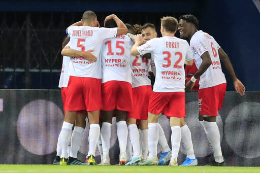 Reims players celebrate after Reims' Hassane Kamara scored his side's opening goal during the French League One soccer match between PSG and Reims at the Parc des Princes stadium in Paris, Wednesday, Sept. 25, 2019. (AP Photo/Michel Euler)