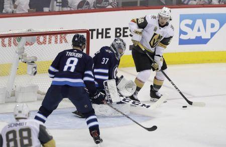 May 20, 2018; Winnipeg, Manitoba, CAN; Vegas Golden Knights left wing Erik Haula (56) prepares to shoot against Winnipeg Jets goaltender Connor Hellebuyck (37) in the second period in game five of the Western Conference Final of the 2018 Stanley Cup Playoffs at Bell MTS Centre. Mandatory Credit: James Carey Lauder-USA TODAY Sports