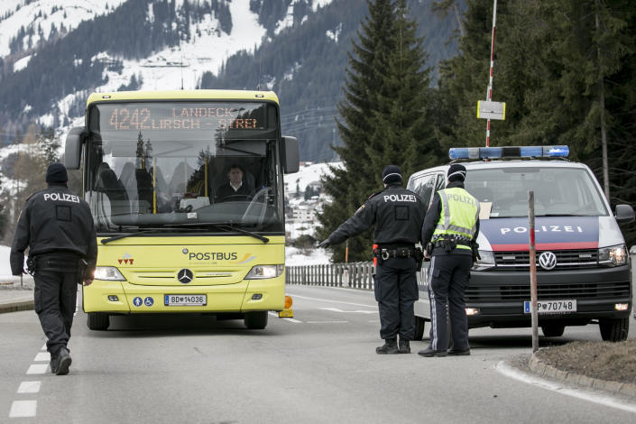 Police at a roadblock stop a bus from driving out of Sankt Anton following the imposition of a quarantine due to a coronavirus outbreak, March 14, 2020, near Landeck, Austria. The ski resort towns of Sankt Anton and Ischgl were both put under quarantine and many ski resorts in the region were closed. / Credit: Jan Hetfleisch/Getty