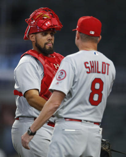 St. Louis Cardinals' Yadier Molina celebrates with manager Mike Shildt (8) following a baseball game against the Atlanta Braves, Tuesday, Sept. 18, 2018, in Atlanta. The Cardinals won 8-1. (AP Photo/Todd Kirkland)