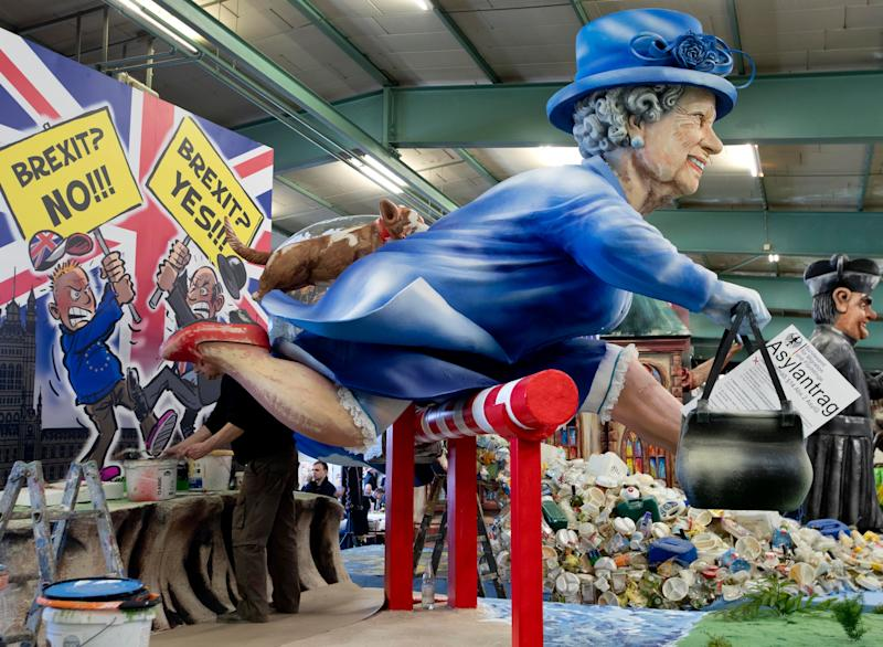 A figure depicting Queen Elizabeth is shown during a press preview in a hall of the Mainz carnival club in Mainz, Germany, Feb. 26, 2019. (Photo: Michael Probst/AP)
