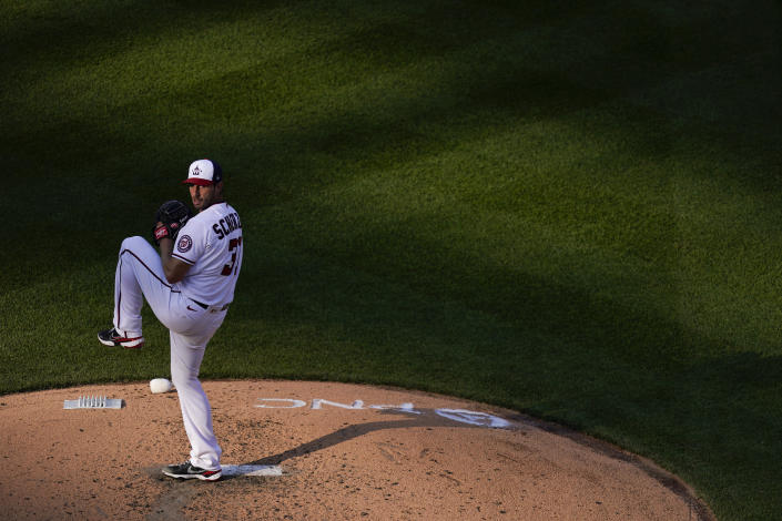 Washington Nationals starting pitcher Max Scherzer throws to the Atlanta Braves in the sixth inning of an opening day baseball game at Nationals Park, Tuesday, April 6, 2021, in Washington. (AP Photo/Alex Brandon)