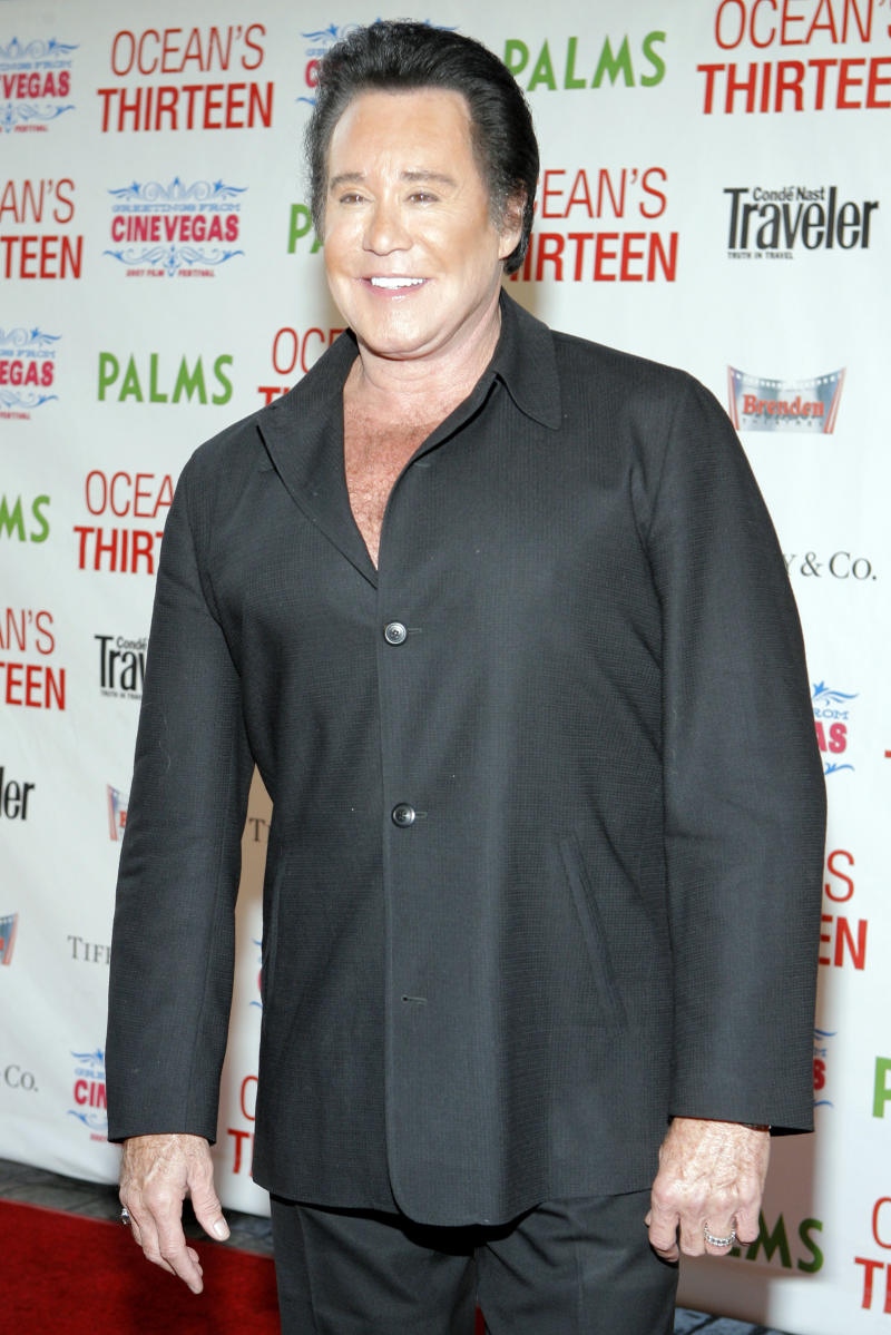 """FILE - This June 6, 2007 file photo shows singer Wayne Newton at the premiere of """"Ocean's Thirteen"""" at the Palms Hotel-Casino in Las Vegas. A federal bankruptcy judge is poised to sign off Friday June 21, 2013, on a legal settlement will result in Newton moving from his sprawling """"Casa de Shenandoah"""" property after 45 years. (AP Photo/Jae C. Hong, File)"""