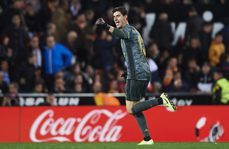 VALENCIA, SPAIN - DECEMBER 15: Thibaut Courtois of Real Madrid CF celebrates scoring his team's goal during the Liga match between Valencia CF and Real Madrid CF at Estadio Mestalla on December 15, 2019 in Valencia, Spain. (Photo by Quality Sport Images/Getty Images)