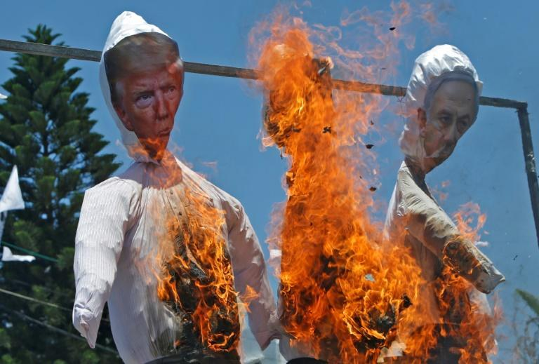 Palestinian protesters burn effigies of US President Donald Trump and Israeli Prime Minister Benjamin Netanyahu in the Gaza Strip on July 7 (AFP Photo/Mohammed ABED)