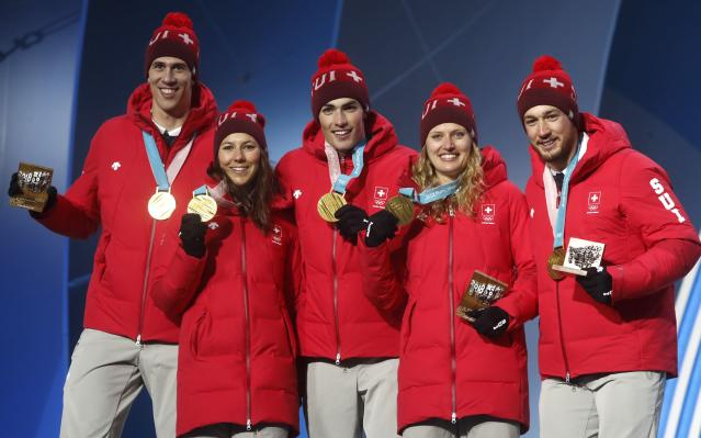Medals Ceremony - Alpine Skiing - Pyeongchang 2018 Winter Olympics - Team Event - Medals Plaza - Pyeongchang, South Korea - February 24, 2018 - Gold medalist Switzerland's team on the podium. REUTERS/Jorge Silva