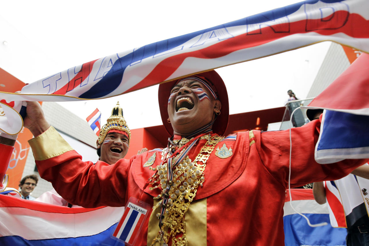 Fans from Thailand cheer before Saturday's women's event at the 2012 Summer Olympics, Saturday, July 28, 2012, in London. (AP Photo/Mike Groll)