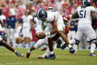 Georgia Southern quarterback Justin Tomlin (17) is tackled by Arkansas Greg Brooks Jr. (9) during the first half of an NCAA college football game Saturday, Sept. 18, 2021, in Fayetteville, Ark. (AP Photo/Michael Woods)