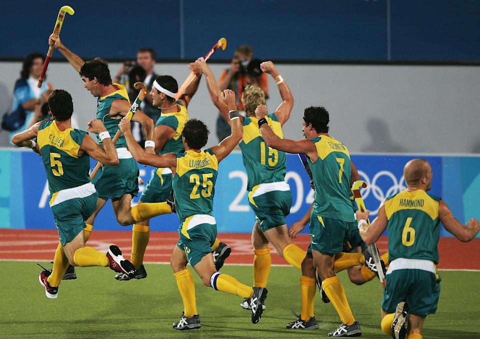ATHENS - AUGUST 27: Australia celebrate their gold medal win after a Jamie Dwyer goal in extra time sealed the win in the men's field hockey event on August 27, 2004 during the Athens 2004 Summer Olympic Games at the Helliniko Olympic Complex Hockey Centre in Athens, Greece. (Photo by Clive Brunskill/Getty Images)