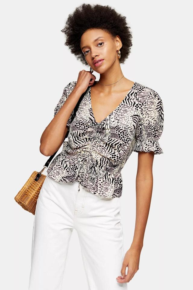 "<p>We adore the print on this <a href=""https://www.popsugar.com/buy/Topshop-Black-Printed-Ruched-Top-583881?p_name=Topshop%20Black%20Printed%20Ruched%20Top&retailer=us.topshop.com&pid=583881&price=35&evar1=fab%3Aus&evar9=36626426&evar98=https%3A%2F%2Fwww.popsugar.com%2Ffashion%2Fphoto-gallery%2F36626426%2Fimage%2F47590475%2FTopshop-Black-Printed-Ruched-Top&list1=shopping%2Ctops%2Csummer%2Csummer%20fashion%2Cfashion%20shopping&prop13=mobile&pdata=1"" rel=""nofollow"" data-shoppable-link=""1"" target=""_blank"" class=""ga-track"" data-ga-category=""Related"" data-ga-label=""https://us.topshop.com/en/tsus/product/clothing-70483/shirts-blouses-4650808/printed-ruched-top-9753785"" data-ga-action=""In-Line Links"">Topshop Black Printed Ruched Top</a> ($35).</p>"