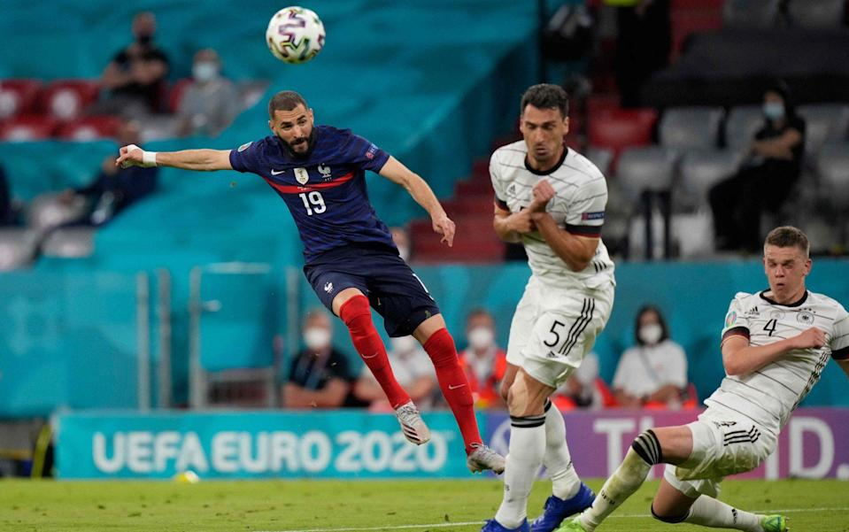 France's forward Karim Benzema (L) attempts a shot as he is marked by Germany's defender Mats Hummels (C) and Germany's defender Matthias Ginter during the UEFA EURO 2020 Group F football match between France and Germany at the Allianz Arena in Munich on June 15 - GETTY IMAGES