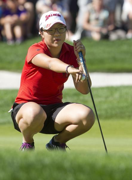 Lydia Ko, from New Zealand, lines up her putt on the fifth green during the third round of the Canadian Women's Open golf tournament in Edmonton, Alberta, Saturday, Aug. 24, 2013. (AP Photo/The Canadian Press, Jason Franson)