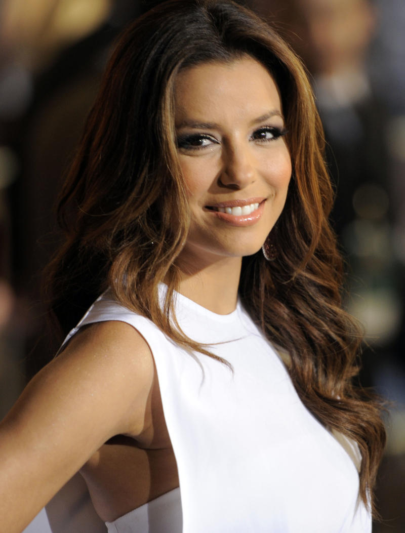 """FILE - In this May 7, 2011 file photo, actress Eva Longoria arrives at the World Premiere of """"Pirates of the Caribbean: On Stranger Tides"""" at Disneyland in Anaheim, Calif. Longoria is an executive producer of the documentary """"The Harvest.""""  (AP Photo/Chris Pizzello, file)"""