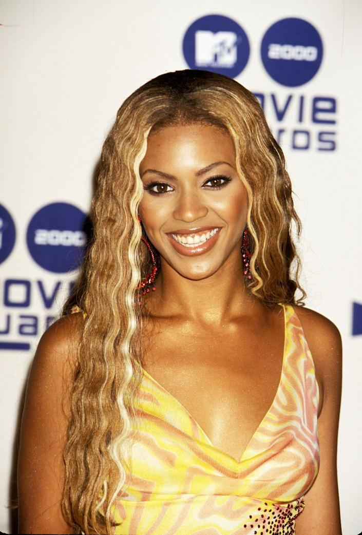 """<p>The 2000s started to see more current-feeling colors and cuts. Case in point: Beyonce's wavy, <a href=""""https://www.goodhousekeeping.com/beauty/hair/news/g2443/blonde-hair-color-ideas/"""" rel=""""nofollow noopener"""" target=""""_blank"""" data-ylk=""""slk:honey blonde"""" class=""""link rapid-noclick-resp"""">honey blonde</a> hair.</p>"""