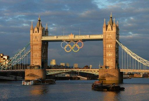 Tower Bridge decorated with the Olympic ring symbol, in central London. The razzmatazz of the London 2012 Olympics is a world away from the last Games held in London in 1948, when athletes had to survive on rations, stitch their own kit and wash it themselves