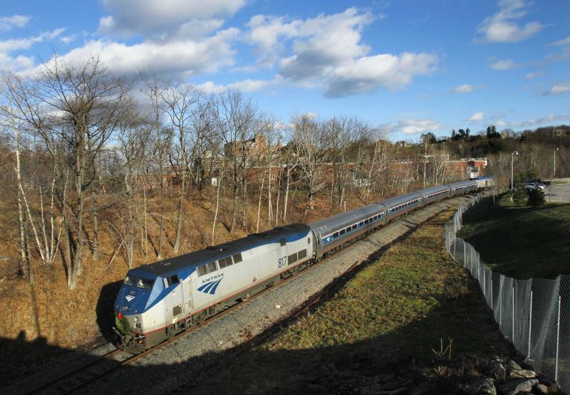 FILE- In this Dec. 8, 2011 file photo, the Amtrak Downeaster travels through Portland, Maine. Amtrak is going to break the speed limit in the Northeast Corridor. The rail service announced Monday, Sept. 24, 2012,  it will operate test trains overnight at 165 mph in four stretches from Maryland to Massachusetts. (AP Photo/Robert F. Bukaty, File)