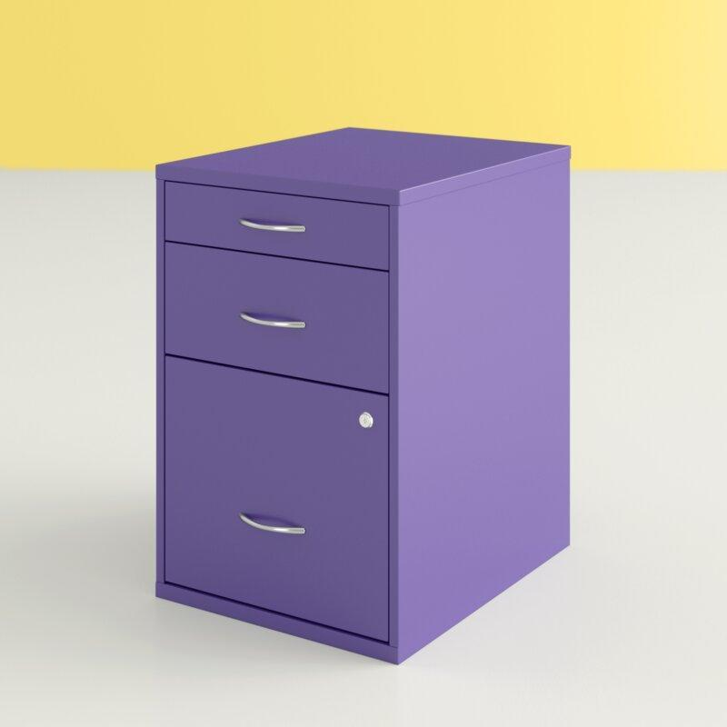 """For your filing needs, Thompson likes the pop of color of this three-drawer cabinet. She says it can """"serve dual functions"""" and by purchasing one that's the same height as your desk, it can even act as an extension of your desk surface. Pro tip: To save space, consider one with wheels so you can stow it in a closet at the end of the work day. $160, Wayfair. <a href=""""https://www.wayfair.com/Hashtag-Home--Medrano-3-Drawer-Vertical-Filing-Cabinet-X111460167-L37-K~W000359056.html?refid=GX444340158883-W000359056_363957569&device=c&ptid=904985744348&network=g&targetid=pla-904985744348&channel=GooglePLA&ireid=84496487&fdid=1817&PiID%5B%5D=363957569&gclid=CjwKCAjw07qDBhBxEiwA6pPbHjk55si2xCFZR2g0pzLq5CXXx8XcPmfdmroTrzBjaU6pL430X-lzqRoCMAIQAvD_BwE&experiencetype=2&selectedvertical=2"""" rel=""""nofollow noopener"""" target=""""_blank"""" data-ylk=""""slk:Get it now!"""" class=""""link rapid-noclick-resp"""">Get it now!</a>"""