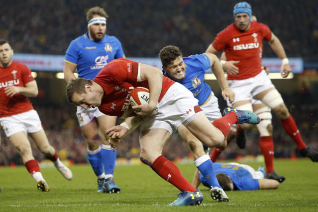 Wales' Hadleigh Parkes goes over the line to score a try during the Six Nations rugby union match between Wales and Italy at the Principality Stadium in Cardiff, Wales, Sunday, March 11, 2018. (AP Photo/Alastair Grant)