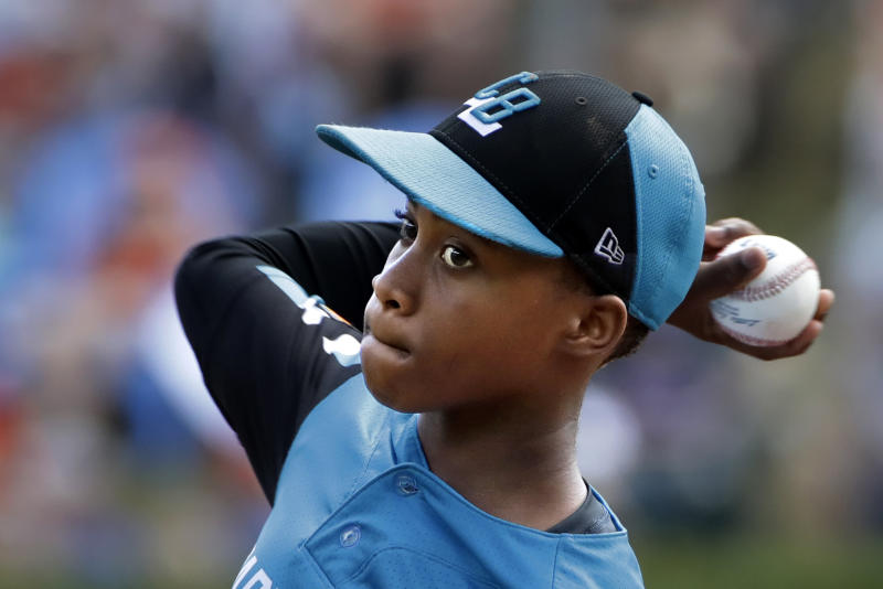Curacao's Shendrion Martinus (6) delivers in the second inning of the International Championship baseball game against Japan at the Little League World Series tournament in South Williamsport, Pa., Saturday, Aug. 24, 2019. (AP Photo/Gene J. Puskar)