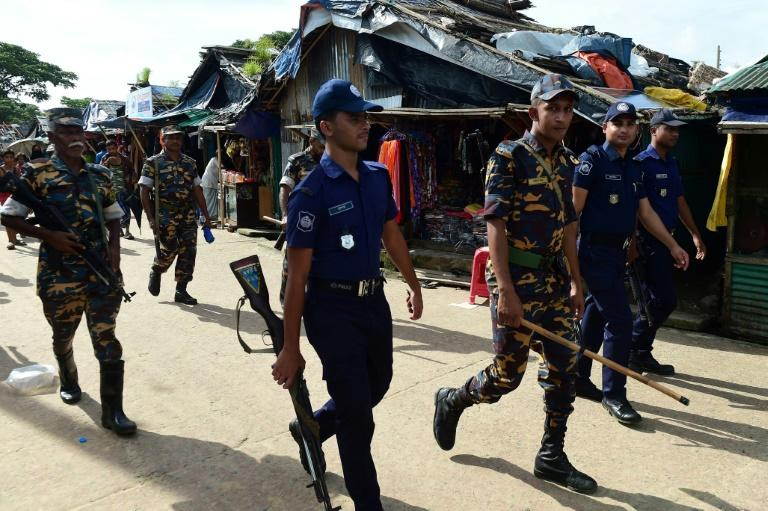 Bangladeshi police patrol in one of the Rohingya refugee camps on the border with Myanmar, where a spate of grisly murders is fuelling unease