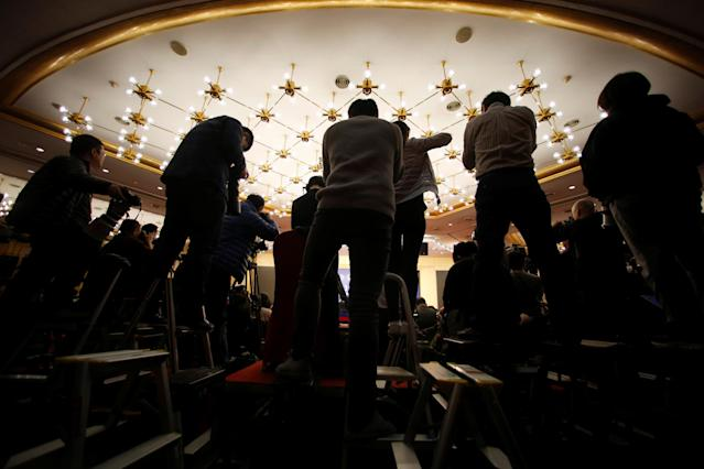 <p>Photographers take pictures during a news conference by Zhou Xiaochuan, governor of the People's Bank of China, at China's National People's Congress (NPC) in Beijing on March 9, 2018. (Photo: Aly Song/Reuters) </p>