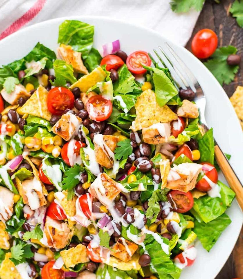 "<p>This salad is loaded with healthy, filling toppings like black beans, corn, and grape tomatoes—and a few crushed tortilla chips, for good measure. Get the recipe <a rel=""nofollow"" href=""http://www.wellplated.com/bbq-chicken-salad?mbid=synd_yahoofood"">here</a>.</p><p><b>Per one serving:</b> <em>329 calories, 19 grams protein</em></p>"
