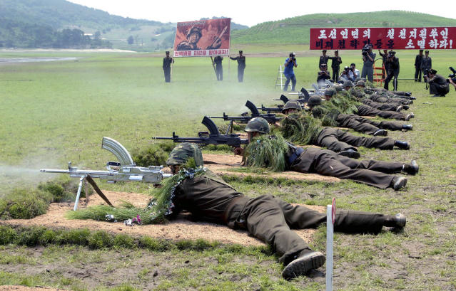 <p>A live-bullet firing demonstration is held by service personnel from the Korean People's Army (KPA) at the Sinchon Museum in South Hwanghae Province in this undated photo. (KCNA/Reuters) </p>