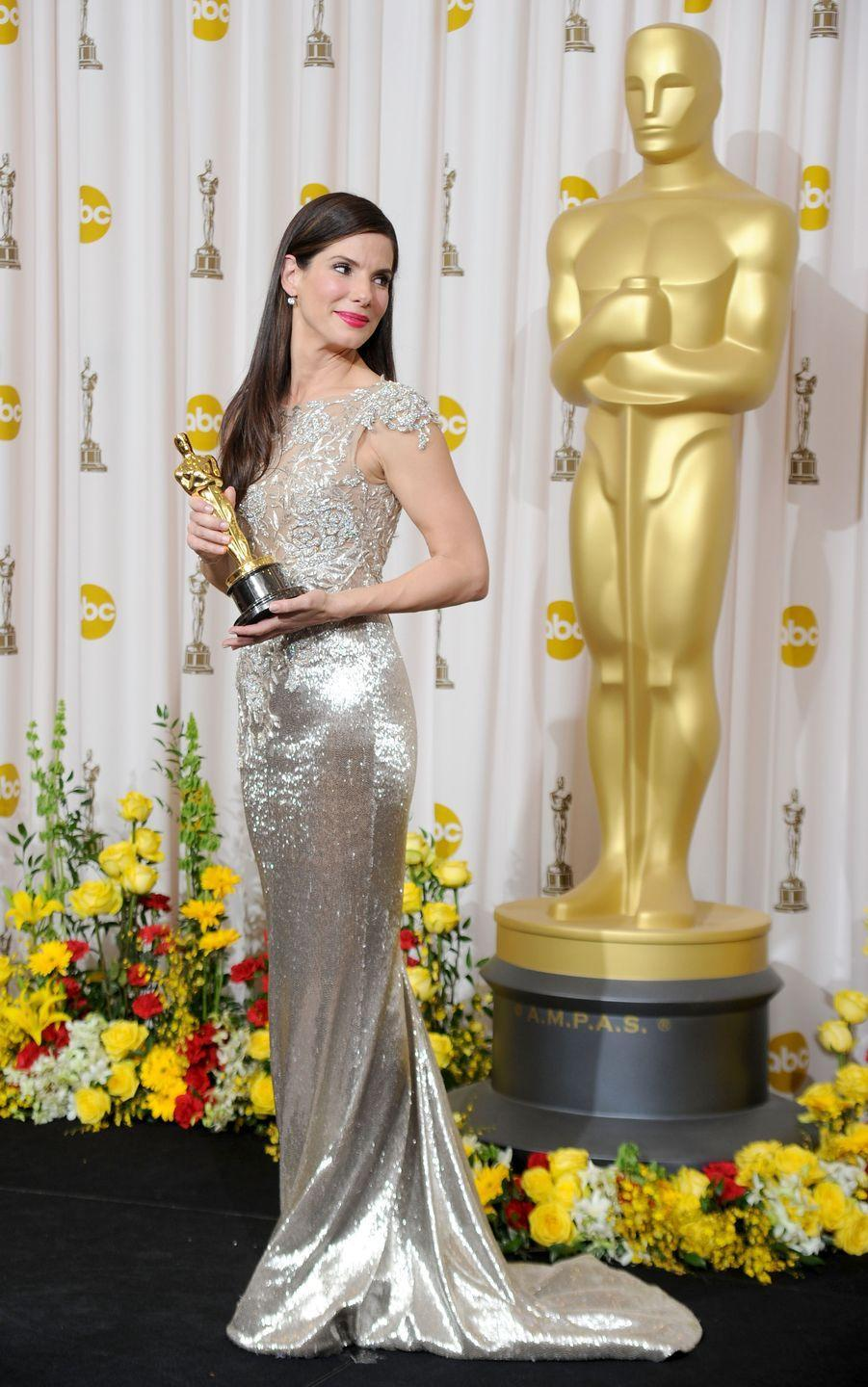 <p>The actress shined in this mermaid gown paired with sleek, straight hair and a bright red lip. She won her long-awaited Oscar for Best Actress in <em>The Blind Side </em>that night.</p>