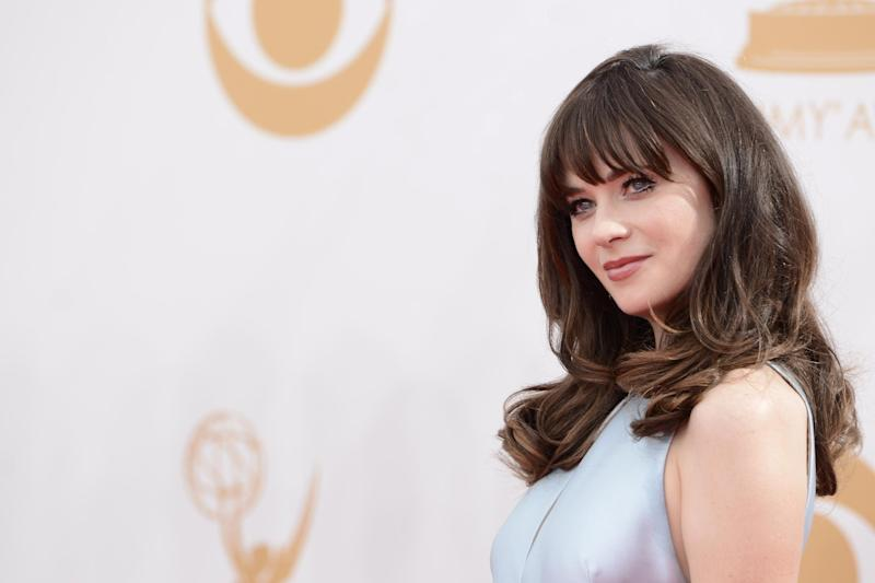 Zooey Deschanel arrives at the 65th Primetime Emmy Awards at Nokia Theatre on Sunday Sept. 22, 2013, in Los Angeles. (Photo by Dan Steinberg/Invision/AP)