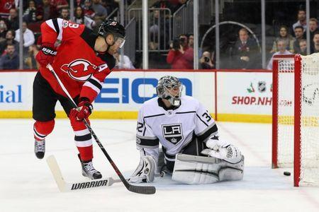 Dec 12, 2017; Newark, NJ, USA; New Jersey Devils left wing Taylor Hall (9) scores a goal on Los Angeles Kings goalie Jonathan Quick (32) during the second period at Prudential Center. Mandatory Credit: Ed Mulholland-USA TODAY Sports