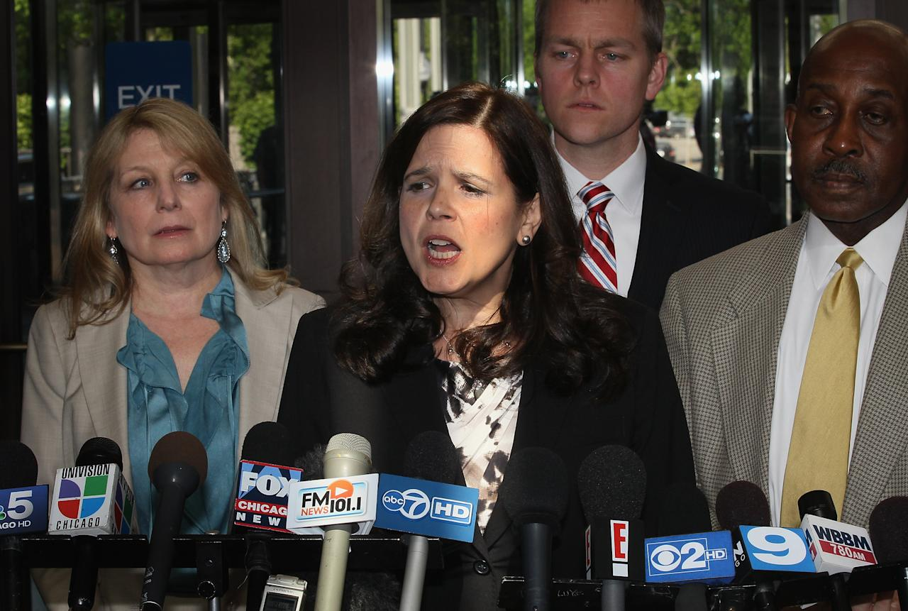 CHICAGO, IL - MAY 11: Amy Thompson (C) speaks for the defense team after the jury declared William Balfour guilty in the October 2008 shooting deaths of the mother, brother and nephew of Oscar-winner Jennifer Hudson's May 11, 2012 in Chicago, Illinois.  Balfour, the ex-husband of Hudson's sister, has been convicted on all of the counts against him, including three counts of first-degree murder, one count of home invasion, one count aggravated kidnapping, one count residential burglary, and one count possession of a stolen motor vehicle.  (Photo by Scott Olson/Getty Images)