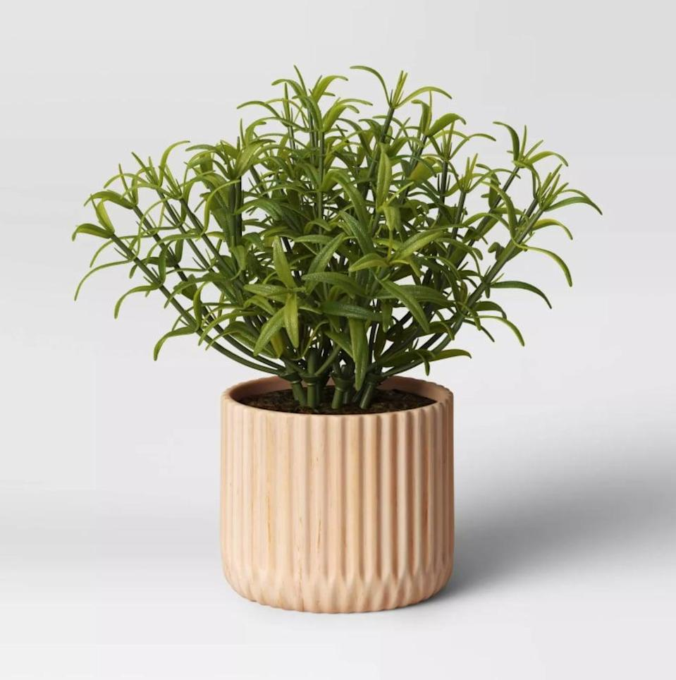 <p>This <span>Opalhouse Faux Wood Planter</span> ($30) will bring style and texture to your garden.</p>