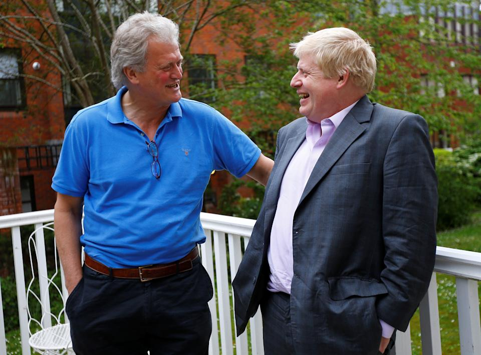 Former London Mayor Boris Johnson (R) speaks with J D Wetherspoon Chairman Tim Martin during a Vote Leave reception in Exeter, Britain May 11, 2016.  REUTERS/Darren Staples