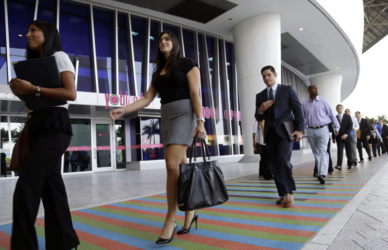 FILE -In this Wednesday, Oct. 23, 2013, file photo, job applicants arrives for an internship job fair held by the Miami Marlins, at Marlins Park in Miami. The government issues the October jobs report, on Friday, Nov. 8, 2013, which had been delayed a week because of the government shutdown. ( AP Photo/Lynne Sladky, File)