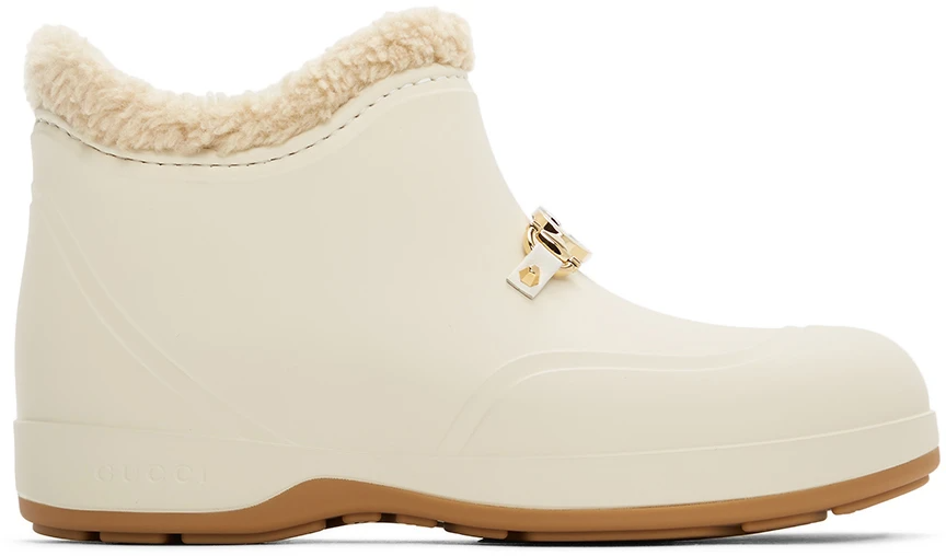 "<br><br><strong>Gucci</strong> Off-White Rubber Horsebit Ankle Boots, $, available at <a href=""https://go.skimresources.com/?id=30283X879131&url=https%3A%2F%2Fwww.ssense.com%2Fen-us%2Fwomen%2Fproduct%2Fgucci%2Foff-white-rubber-horsebit-ankle-boots%2F5405321"" rel=""nofollow noopener"" target=""_blank"" data-ylk=""slk:SSENSE"" class=""link rapid-noclick-resp"">SSENSE</a>"