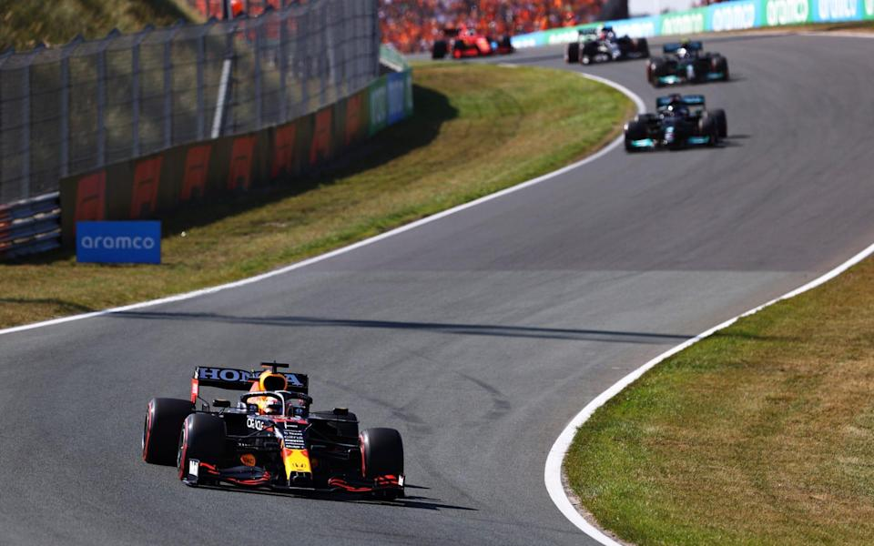 Red Bull Racing RB16B Honda leads Lewis Hamilton of Great Britain driving the (44) Mercedes AMG Petronas F1 Team Mercedes W12 during the F1 Grand Prix of The Netherlands at Circuit Zandvoort on September 05, 2021 in Zandvoort, Netherland - Formula 1/Formula 1 via Getty Images