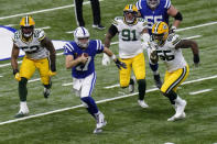 Indianapolis Colts quarterback Philip Rivers (17) runs during the first half of an NFL football game against the Green Bay Packers, Sunday, Nov. 22, 2020, in Indianapolis. (AP Photo/AJ Mast)