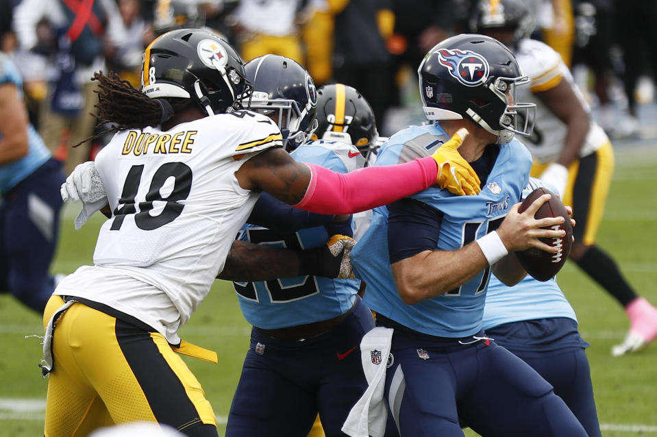 Pittsburgh Steelers outside linebacker Bud Dupree (48) grabs Tennessee Titans quarterback Ryan Tannehill (17) in the first half of an NFL football game Sunday, Oct. 25, 2020, in Nashville, Tenn. (AP Photo/Wade Payne)