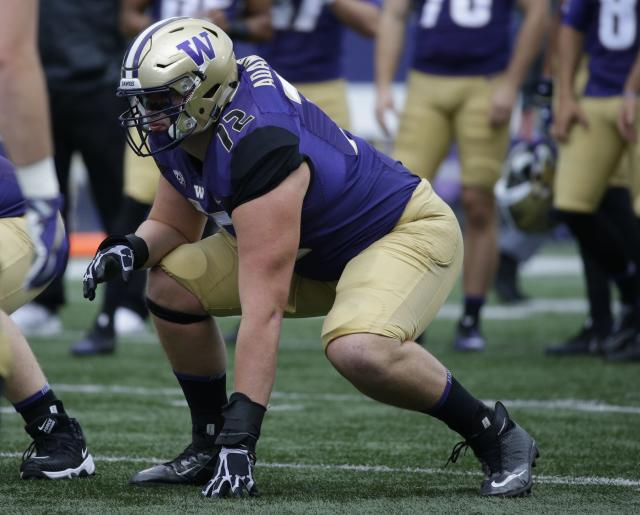 """Washington offensive lineman <a class=""""link rapid-noclick-resp"""" href=""""/ncaaf/players/251110/"""" data-ylk=""""slk:Trey Adams"""">Trey Adams</a> lines up during warmups before an NCAA college football game against Montana, Saturday, Sept. 9, 2017, in Seattle. (AP Photo/Ted S. Warren)"""