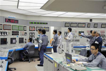 File photo of workers of Kansai Electric Power Co's Ohi nuclear power plant monitoring the restart of the No. 3 unit in Ohi